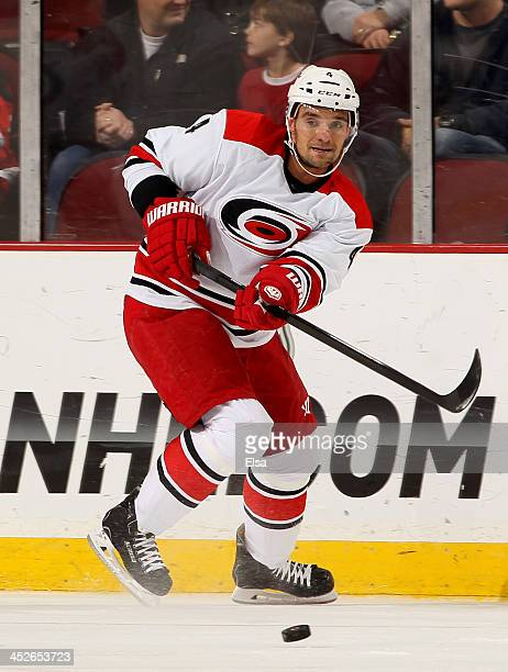 Andrej Sekera of the Carolina Hurricanes takes the puck in the first period against the New Jersey Devils at Prudential Center on November 27 2013 in...