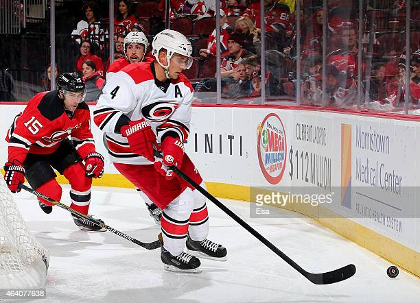 Andrej Sekera of the Carolina Hurricanes wraps around the net as Tuomo Ruutu of the New Jersey Devils defends on February 21 2015 at the Prudential...