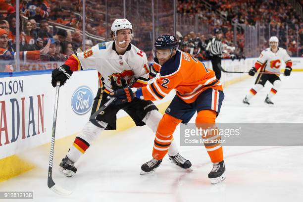 Andrej Sekera of the Edmonton Oilers battles against Matthew Tkachuk of the Calgary Flames at Rogers Place on January 25 2018 in Edmonton Canada