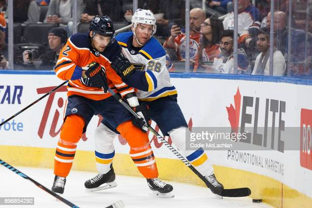 Andrej Sekera of the Edmonton Oilers battles against Paul Stastny of the St Louis Blues at Rogers Place on December 21 2017 in Edmonton Canada
