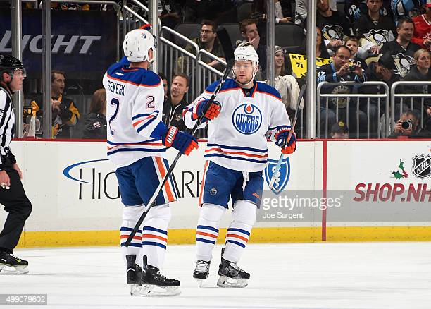 Andrej Sekera of the Edmonton Oilers celebrates his power play goal with Mark Letestu of the Edmonton Oilers during the first period against the...