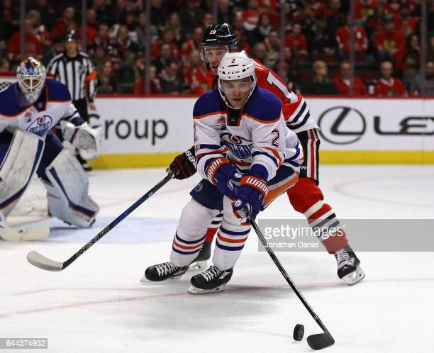 Andrej Sekera of the Edmonton Oilers controls the puck in front of Jonathan Toews of the Chicago Blackhawks at the United Center on February 18 2017...