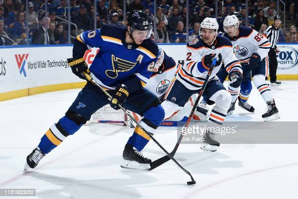 Andrej Sekera of the Edmonton Oilers defends against Alexander Steen of the St Louis Blues at Enterprise Center on March 19 2019 in St Louis Missouri