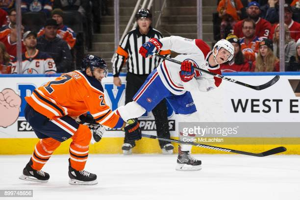 Andrej Sekera of the Edmonton Oilers defends against Daniel Carr of the Montreal Canadiens at Rogers Place on December 23 2017 in Edmonton Canada
