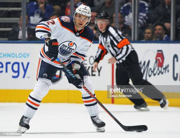 Andrej Sekera of the Edmonton Oilers gets set to make a pass against the Toronto Maple Leafs during an NHL game at Scotiabank Arena on February 27...
