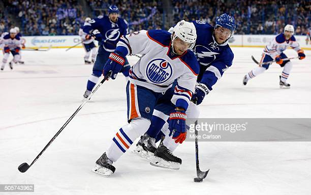Andrej Sekera of the Edmonton Oilers is checked by Victor Hedman of the Tampa Bay Lightning during the third period at the Amalie Arena on January 19...