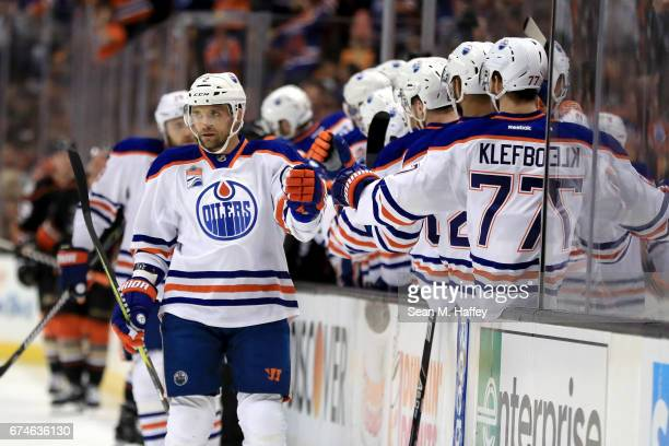 Andrej Sekera of the Edmonton Oilers is congratulated at the bench by teammates after scoring a goal during the first period of Game Two of the...