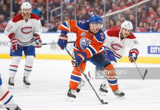 Andrej Sekera of the Edmonton Oilers is pursued by Andrew Shaw of the Montreal Canadiens on March 12 2017 at Rogers Place in Edmonton Alberta Canada