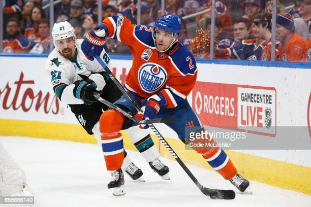 Andrej Sekera of the Edmonton Oilers is pursued by Joonas Donskoi of the San Jose Sharks in Game Two of the Western Conference First Round during the...