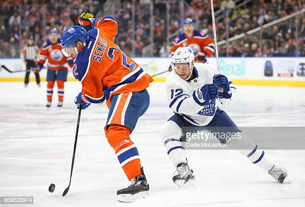 Andrej Sekera of the Edmonton Oilers keeps the puck away from Stephane Robidas of the Toronto Maple Leafs on November 29 2016 at Rogers Place in...