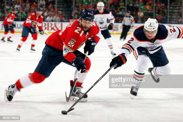 Andrej Sekera of the Edmonton Oilers poke checks Vincent Trocheck of the Florida Panthers during first period action at the BBT Center on March 17...