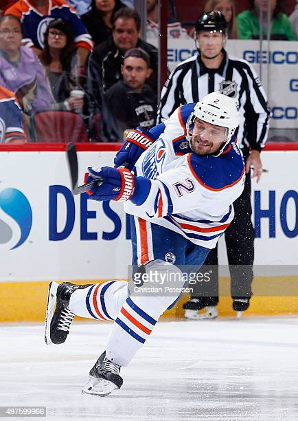 Andrej Sekera of the Edmonton Oilers shoots the puck during the NHL game against the Arizona Coyotes at Gila River Arena on November 12 2015 in...