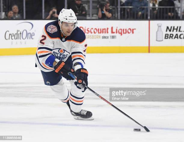 Andrej Sekera of the Edmonton Oilers skates with the puck against the Vegas Golden Knights in the first period of their game at TMobile Arena on...