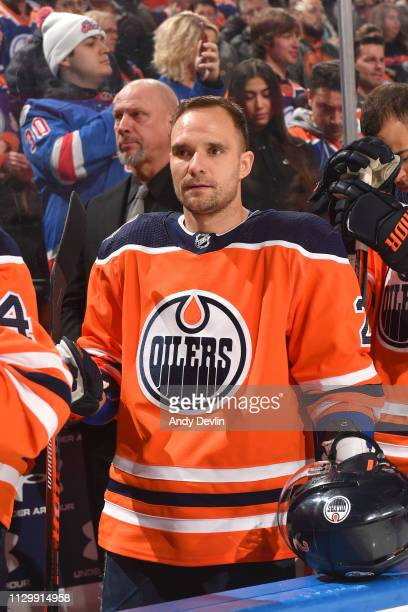 Andrej Sekera of the Edmonton Oilers stands for the singing of the national anthem prior to the game against the New York Rangers on March 11 2019 at...