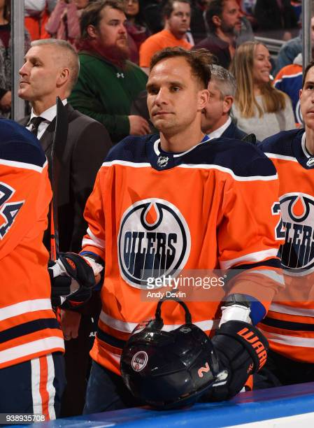 Andrej Sekera of the Edmonton Oilers stands for the singing of the national anthem prior to the game against the Columbus Blue Jackets on March 27...