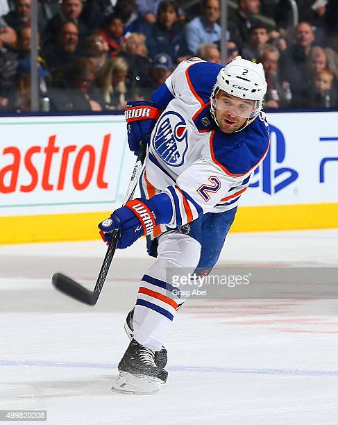 Andrej Sekera of the Edmonton Oilers takes a shot against the Edmonton Oilers during game action on November 30 2015 at Air Canada Centre in Toronto...