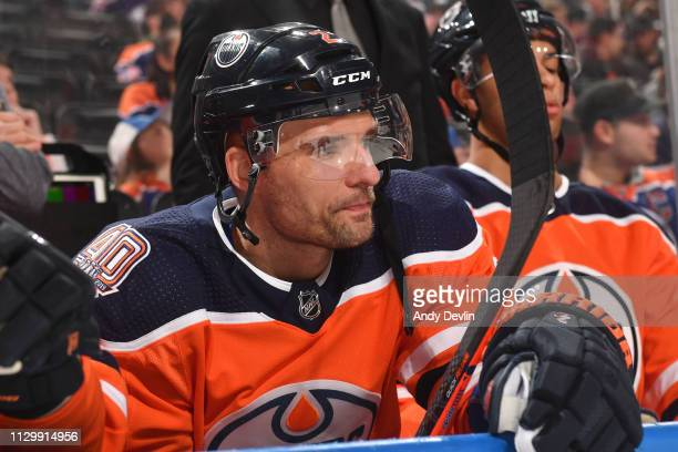 Andrej Sekera of the Edmonton Oilers watches from the bench prior to the game against the New York Rangers on March 11 2019 at Rogers Place in...