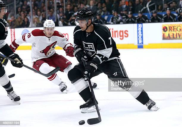Andrej Sekera of the Los Angeles Kings controls the puck in front of Lauri Korpikoski of the Arizona Coyotes at Staples Center on March 16 2015 in...