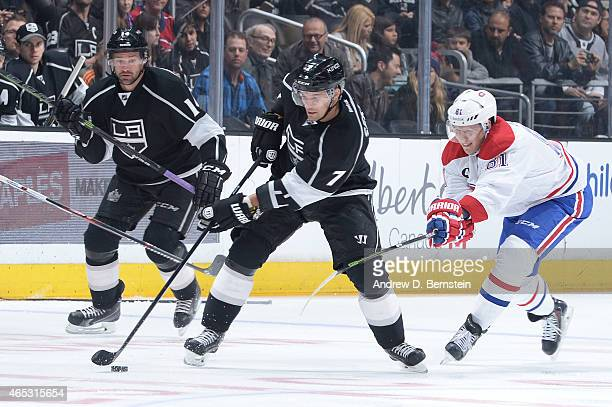 Andrej Sekera of the Los Angeles Kings handles the puck against Lars Eller of the Montreal Canadiens as Justin Williams of the Los Angeles Kings...