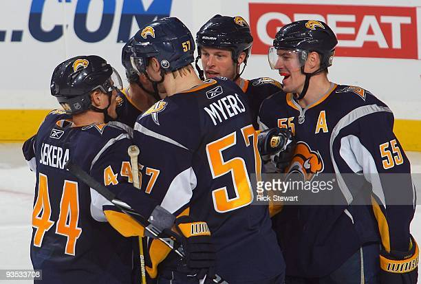 Andrej Sekera Tyler Myers Tim Connolly and Jochen Hecht of the Buffalo Sabres huddle together to celebrate after a play against the Carolina...