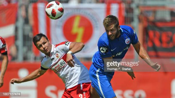 Andrej Startsev of Cottbus and Marco Koenigs of Rostock head for the ball during the 3. Liga match between FC Energie Cottbus and F.C. Hansa Rostock...