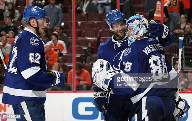 Andrej Sustr and Victor Hedman congratulate goaltender Andrei Vasilevskiy of the Tampa Bay Lightning after shutting out the Philadelphia Flyers 30 on...