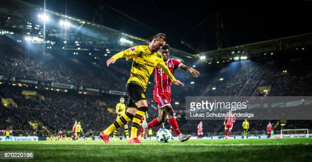 Andrej Yarmolenko of Dortmund and Kingsley Coman of Munich in action during the Bundesliga match between Borussia Dortmund and FC Bayern Muenchen at...