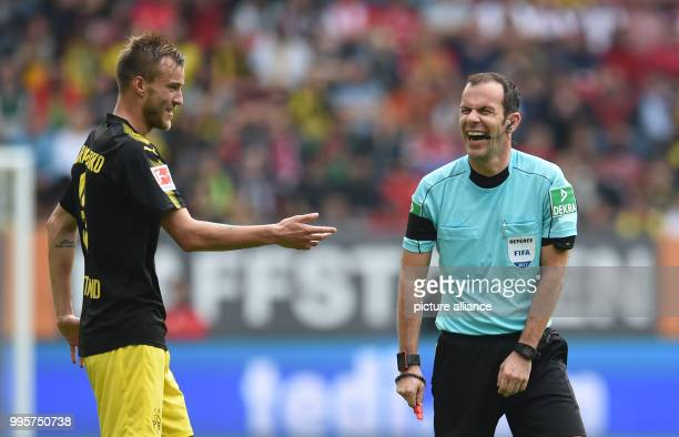 Andrej Yarmolenko of Dortmund and referee Marco Fritz in conversation during the German Bundesliga football match between FC Augsburg and Borussia...