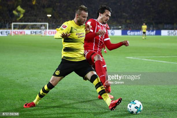 Andrej Yarmolenko of Dortmund fights for the ball with Mats Hummels of Bayern Muenchen during the Bundesliga match between Borussia Dortmund and FC...