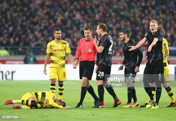 Andrej Yarmolenko of Dortmund is injured on the ground and Jeremy Toljan of Dortmund Holger Badstuber of Stuttgart Emiliano Insua of Stuttgart and...