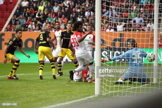 Andrej Yarmolenko of Dortmund scores his teams first goal to make it 11 during the Bundesliga match between FC Augsburg and Borussia Dortmund at...
