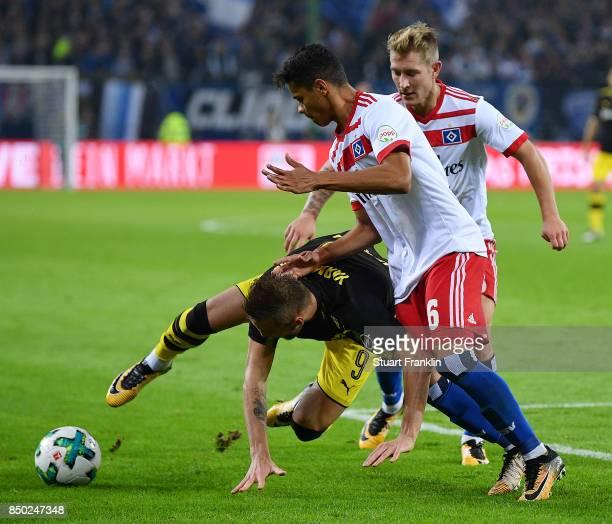 Andrej Yaromolenko of Dortmund Lewis Holtby of Hamburg and Douglas Santos of Hamburg during the Bundesliga match between Hamburger SV and Borussia...