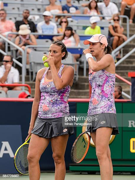 Andreja Klepac and Katarina Srebotnik of Slovenia discuss their strategy against Simona Halep and Monica Niculescu of Romania during day six in...