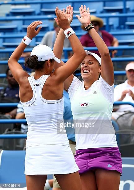 Andreja Klepac of Slovenia and Silvia SolerEspinosa of Spain celebrate after they defeated Marina Erakovic of New Zealand and Arantxa Parra Santonja...