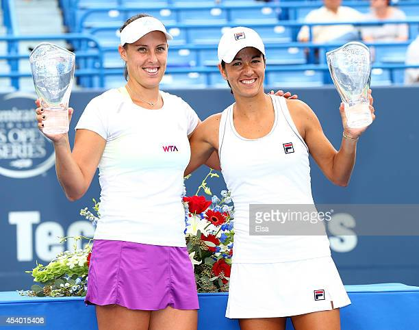 Andreja Klepac of Slovenia and Silvia SolerEspinosa of Spain celebrate with their trophies after they defeated Marina Erakovic of New Zealand and...