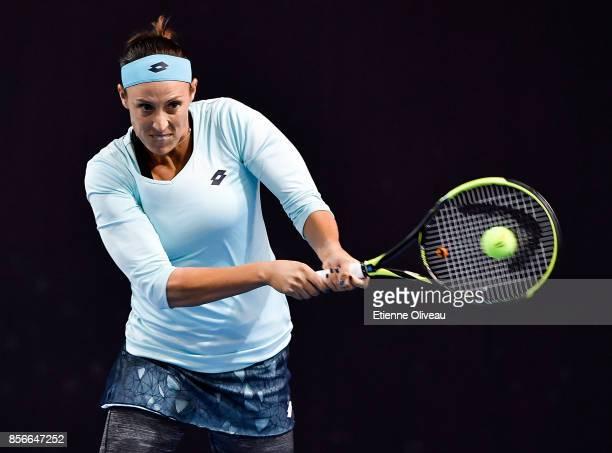 Andreja Klepac of Slovenia returns a shot in her match in partnership with Andreja Klepac of Slovenia against Zhaoxuan Yang of China and Shuko Aoyama...