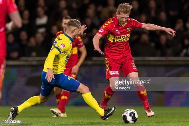 Andrejs Ciganiks of SC Cambuur Richard van der Venne of Go Ahead Eagles during the First Division match between Go Ahead Eagles and SC Cambuur...