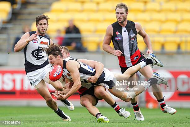 Andrejs Everitt of Carlton is tackled by Luke Dunstan of St Kilda during the round four AFL match between the St Kilda Saints and the Carlton Blues...