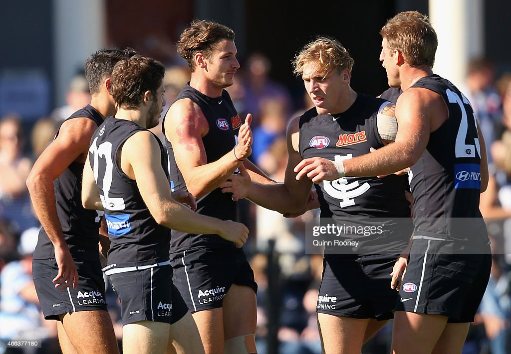Andrejs Everitt of the Blues is congratulated by team mates after kicking a goal during the NAB Challenge AFL match between the Collingwood Magpies and the Carlton Blues at Queen Elizabeth Oval on March 15, 2015 in Bendigo, Australia.