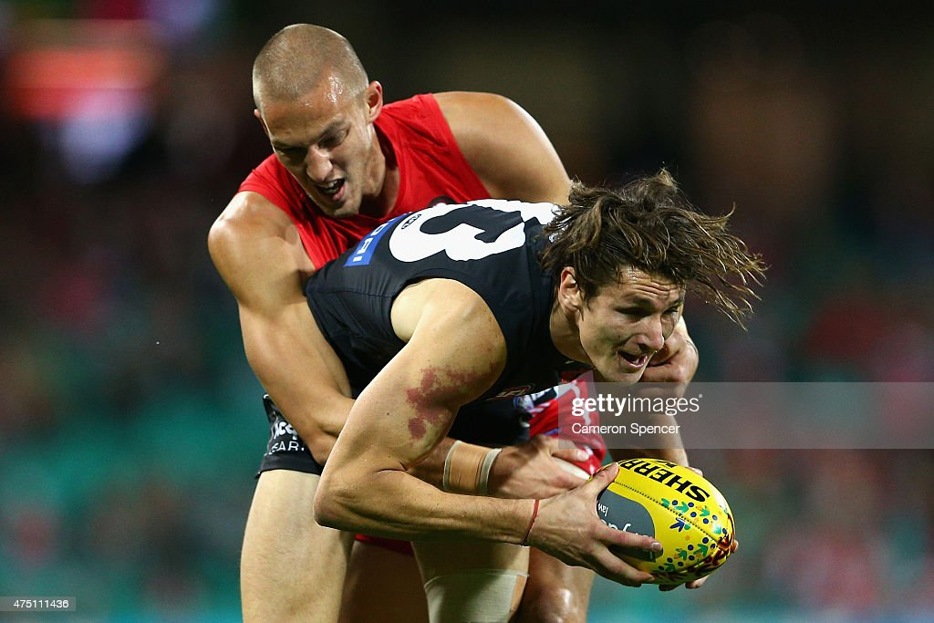 Andrejs Everitt of the Blues is tackled by Sam Reid of the Swans during the round nine AFL match between the Sydney Swans and the Carlton Blues at SCG on May 29, 2015 in Sydney, Australia.