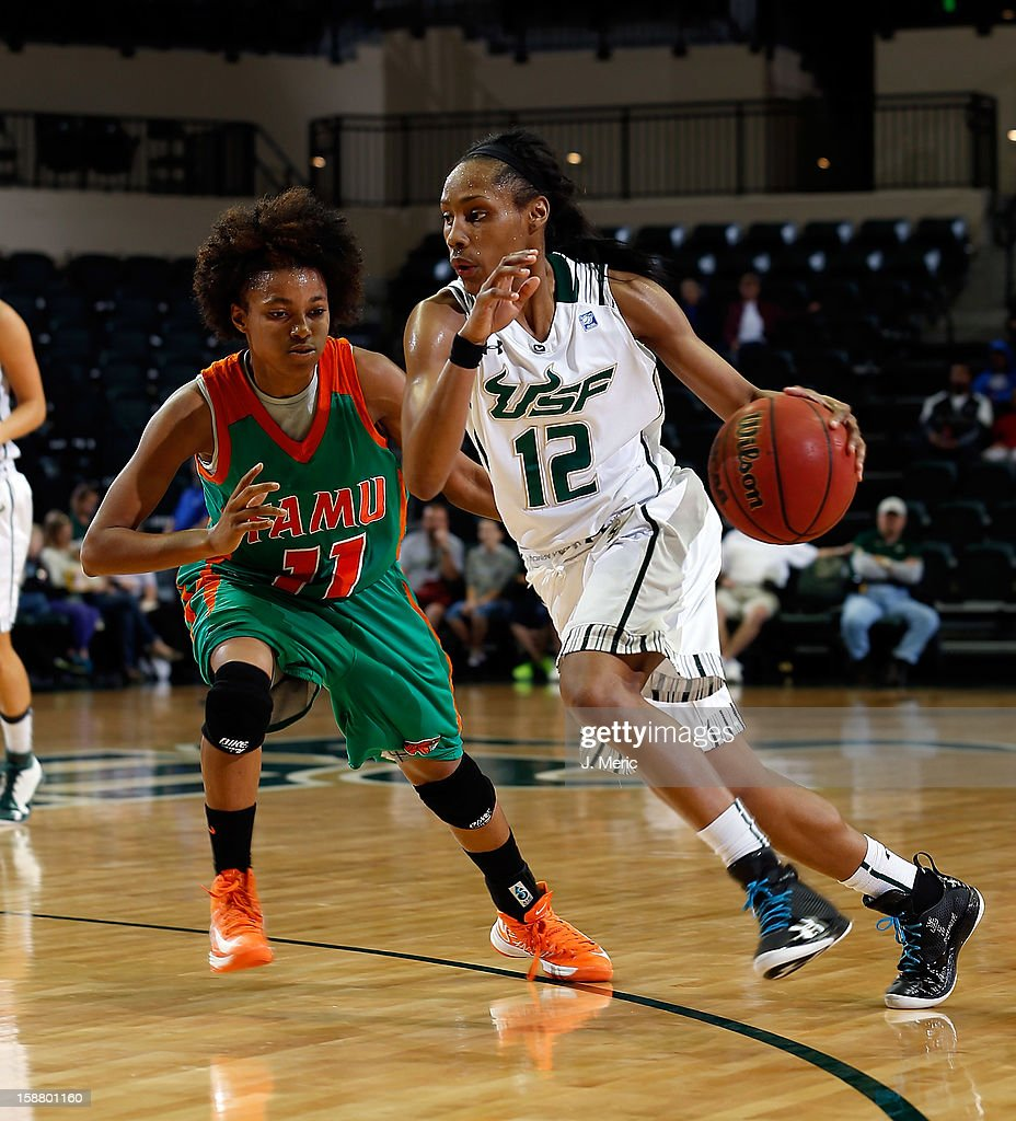 Andrell Smith #12 of the South Florida Bulls drives to the basket as Andreya Lacy #11 of the Florida A&M Rattlers defends during the game at the Sun Dome on December 29, 2012 in Tampa, Florida.