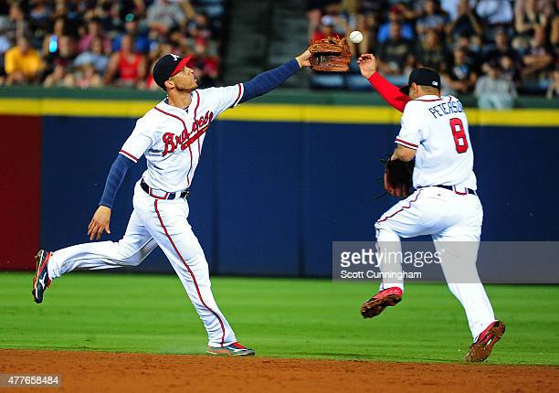 Andrelton Simmons and Jace Peterson of the Atlanta Braves are not able to reach a sixth inning base hit up the middle by Brock Holt of the Boston Red...