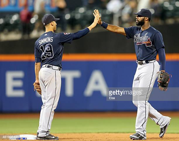 Andrelton Simmons and Jason Heyward of the Atlanta Braves celebrate the win over the New York Mets on July 10 2014 at Citi Field in the Flushing...