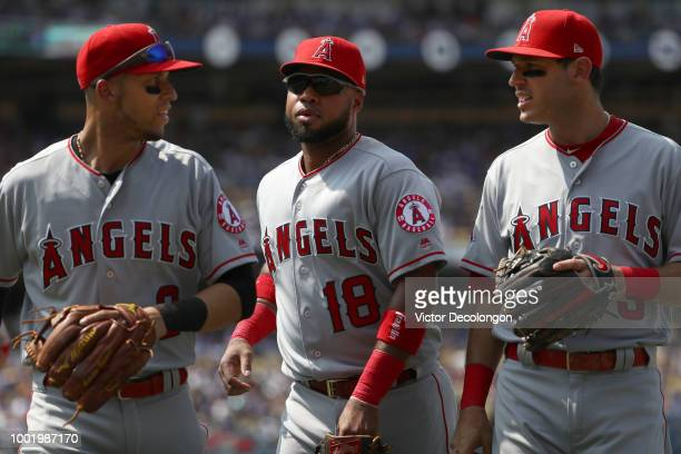 Andrelton Simmons Luis Valbuena and Andrelton Simmons of the Los Angeles Angels of Anaheim walk back to the dugout after the sixth inning during the...