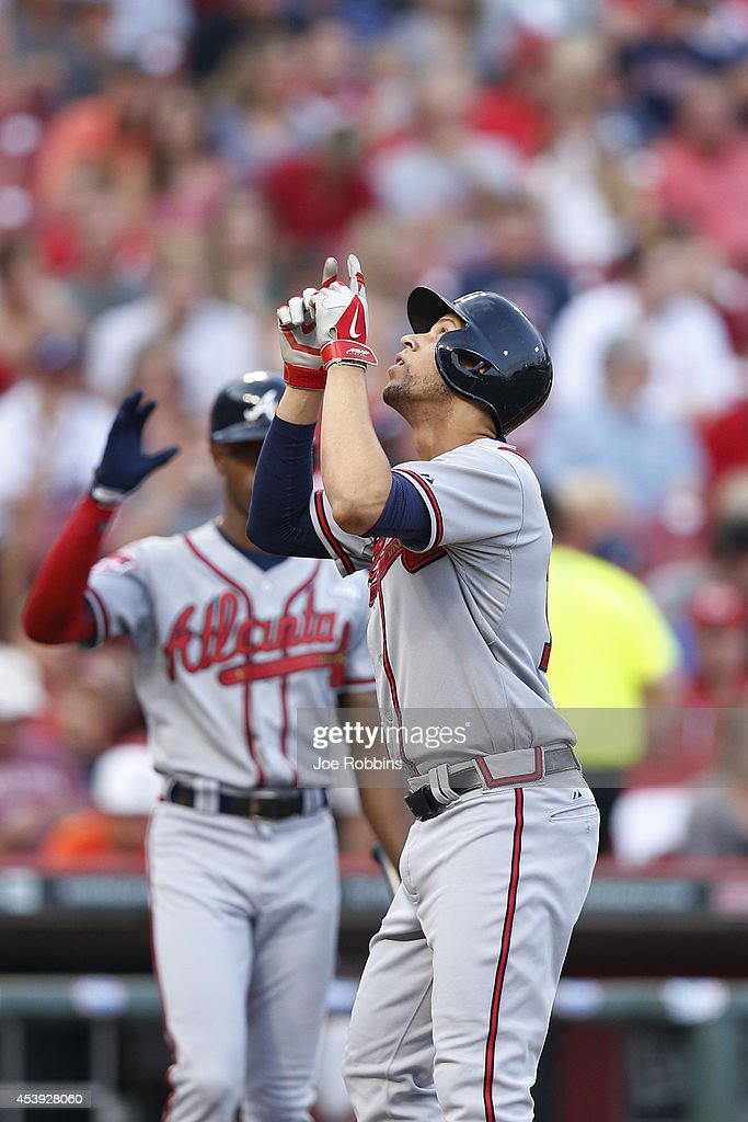 Andrelton Simmons #19 of the Atlanta Braves celebrates after hitting a home run in the second inning of the game against the Cincinnati Reds at Great American Ball Park on August 21, 2014 in Cincinnati, Ohio.
