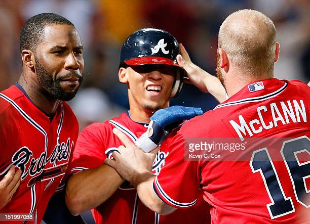 Andrelton Simmons of the Atlanta Braves celebrates scoring the gamewinning run on a walkoff single by Tyler Pastornicky in the ninth inning against...
