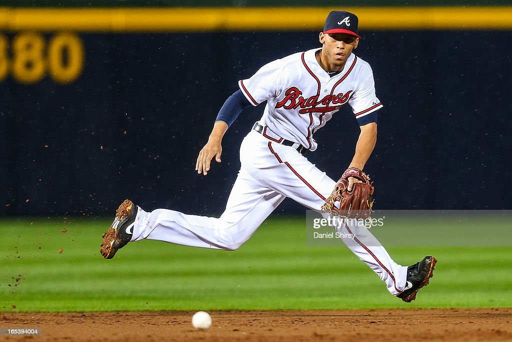 Andrelton Simmons #19 of the Atlanta Braves fields a ground ball in the second inning of the game against the Philadelphia Phillies at Turner Field on April 3, 2013 in Atlanta, Georgia.