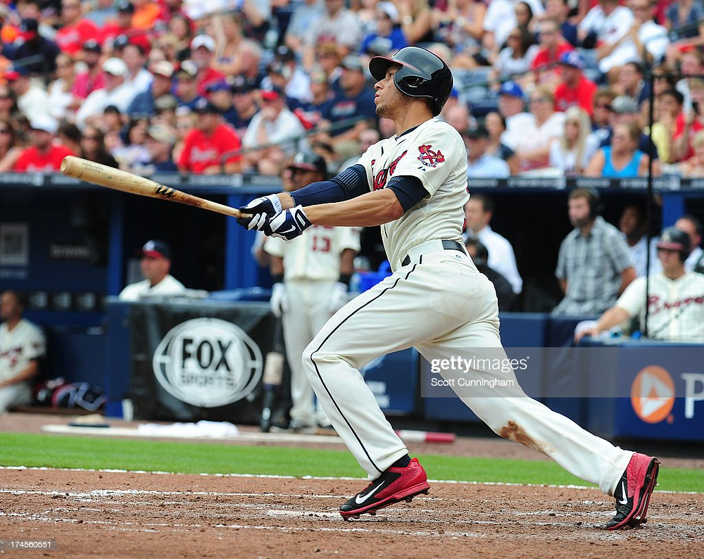 Andrelton Simmons #19 of the Atlanta Braves hits a two run double in the eighth inning against the St. Louis Cardinals at Turner Field on July 27, 2013 in Atlanta, Georgia.