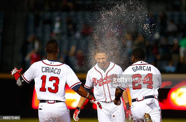 Andrelton Simmons of the Atlanta Braves is doused with liquid after hitting a walkoff RBI single in the ninth inning against the Toronto Blue Jays at...