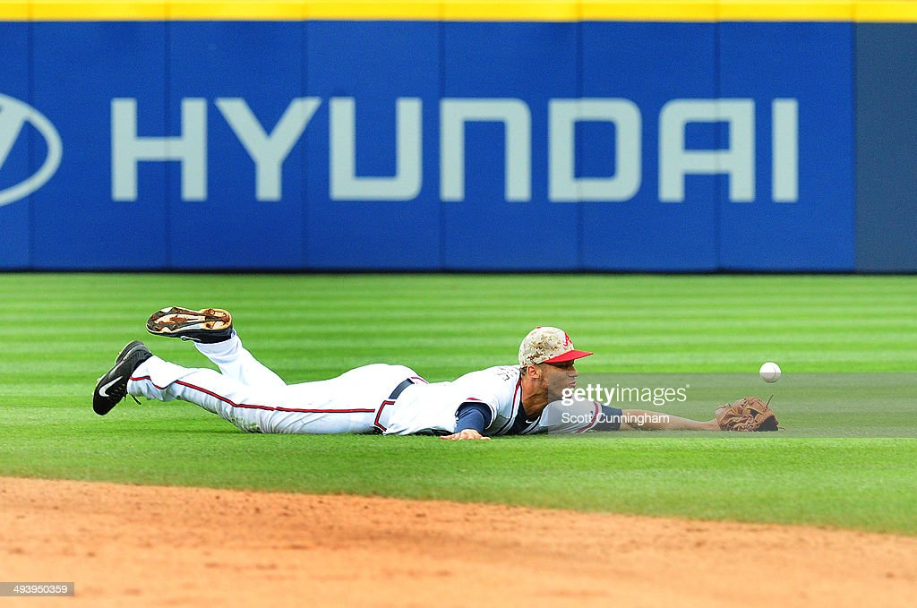 Andrelton Simmons #19 of the Atlanta Braves is unable to reach a 7th inning run scoring single by A.J. Pierzynski of the Boston Red Sox (not pictured) at Turner Field on May 26, 2014 in Atlanta, Georgia.